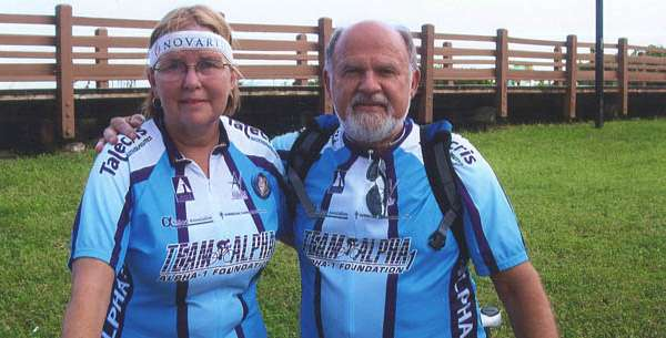 received a lung transplant on Nov. 22, 2001 at Shands at UF. Now, she is in good health and rides her bike with Team Alpha 1, part of the Alpha 1 Foundation. She is shown here with John Walsh, president and CEO of the Alpha-1 Foundation.