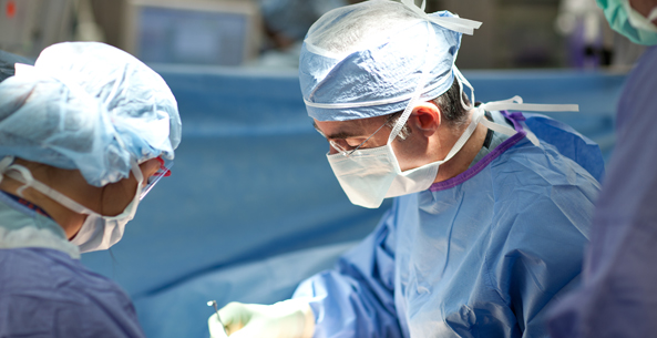 Two doctors performing a surgery