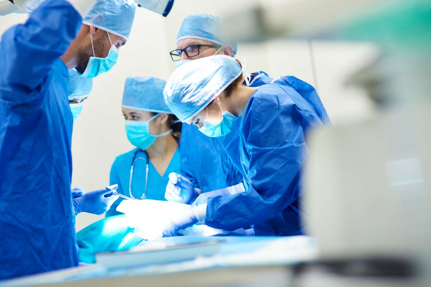 Close up of surgery team operating