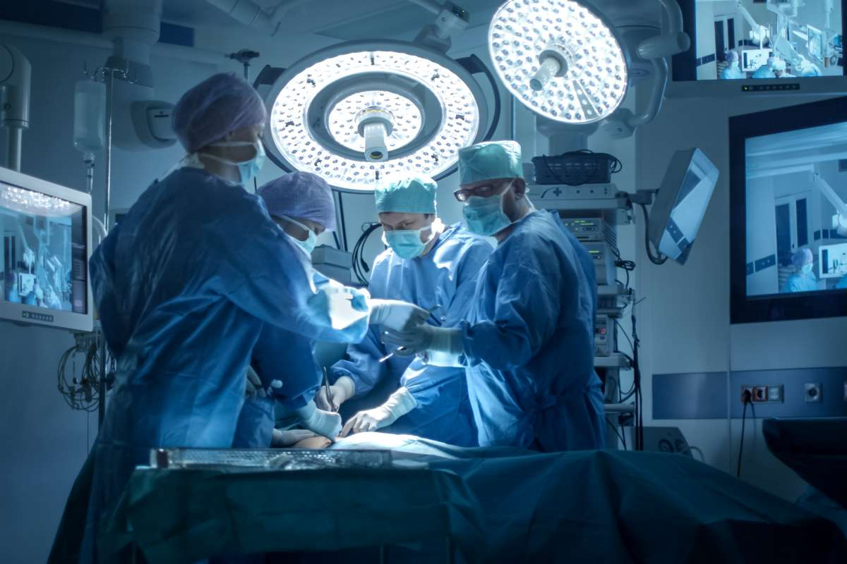Medical Team Performing Surgical Operation in Modern Operating Room
