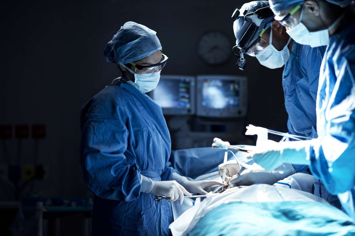 Shot of a team of surgeons performing a surgery in an operating room