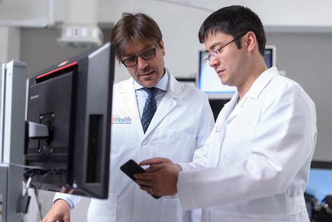 Drs. Andres Pelaez and Tiago Machuca discuss