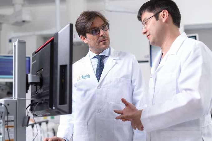 surgeons speaking over computer