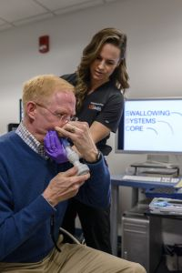 """University of Florida researchers examine the """"invisible"""" and extremely challenging condition of swallowing disorders, which often afflict patients with throat cancer as well as those with neurodegenerative disorders or trauma to the neck. It significantly affects day-to-day life, making it a challenge to eat and avoid coming down with aspiration pneumonia."""