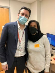 Photo of Christina Hall and Thiago Beduschi in clinic.